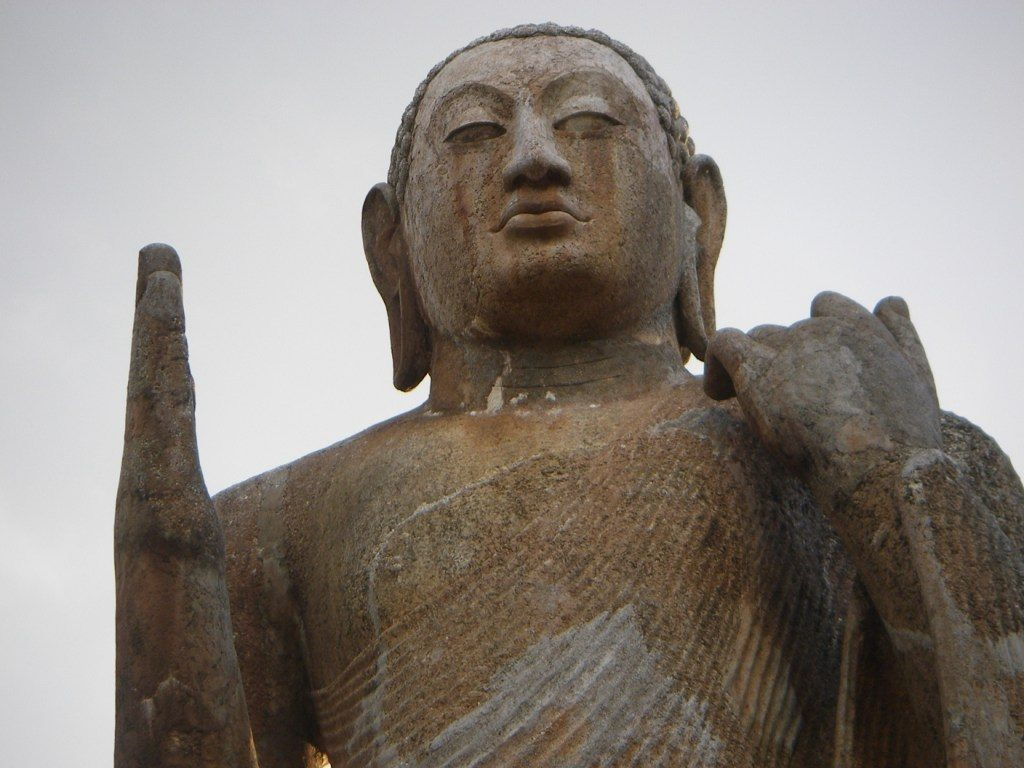 At Okkampitiya, a 10 meter tall Buddha from the 7th century looks down